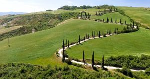 Amazing aerial view of Tuscany countryside winding road in sprin. G season - Italy stock photo