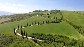 Amazing aerial view of Tuscany countryside winding road in sprin. G season - Italy royalty free stock photo
