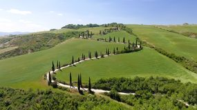 Amazing aerial view of Tuscany countryside winding road in spring season - Italy.  royalty free stock photo