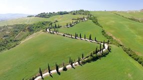 Amazing aerial view of Tuscany countryside winding road in sprin. G season - Italy royalty free stock image