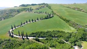 Amazing aerial view of Tuscany countryside winding road in sprin. G season - Italy stock photos