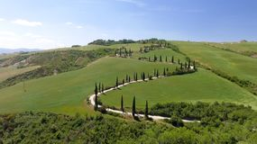 Amazing aerial view of Tuscany countryside winding road in sprin. G season - Italy royalty free stock images