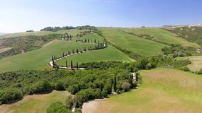 Amazing aerial view of Tuscany countryside winding road in sprin. G season - Italy stock photography
