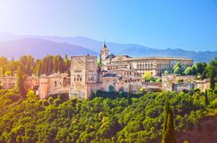 Amazing Alhambra palace complex taken in the morning in sunrise light. Beautiful piece of Moorish architecture. Surrounded by green trees, is located in stock image