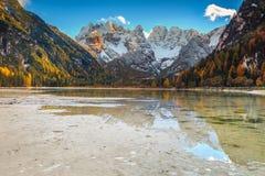 Amazing alpine lake with high peaks in background, Dolomites, Italy Stock Image