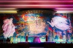Amazing Altar at the Catholic Chapel at the Air Force Academy Chapel. Mosaics, stone relief images and amazing colors drench the beautiful altar at the Catholic stock photography
