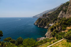 Amazing Amalfi Coast. Stunning summer view over the picturesque Amalfi coast in Italy - crystal clear Meditteranean sea, rocky mountains and blue sky Stock Photos