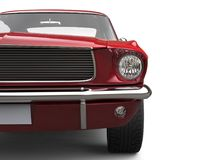 Amazing American vintage muscle car - cherry red - front view closeup cut shot Stock Photo