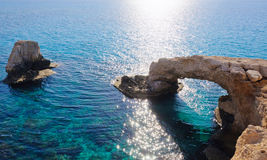 Amazing arch, cliff. Blue deep rocky sea Royalty Free Stock Images