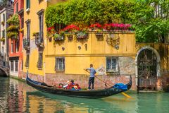 Amazing architecture and gondola on narrow Venice canals. Beautiful view of traditional gondola on famous Venice canals, Italy Stock Image