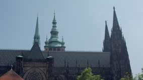 Amazing architecture of old gothic building of Saint Vitus Cathedral, side view. In sunny day stock footage