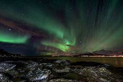 Amazing aurora borealis - northern lights. View from coast in Oldervik, near Tromso city - north Norway royalty free stock image