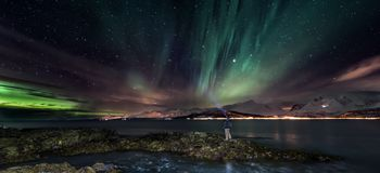 Aurora borealis - northern lights, North Norway - banner. Amazing aurora borealis - northern lights - view from coast in Oldervik, near Tromso city - north stock photo