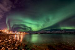 Aurora Borealis northern lights in North Norway. Amazing aurora borealis - northern lights - view from coast in Vagnes, near Tromso city - north Norway royalty free stock photography