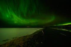 Amazing Aurora Borealis over a lake in Iceland. Royalty Free Stock Photo