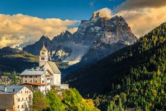 Amazing autumn landscape with church on the hill, Dolomites, Italy Stock Photos