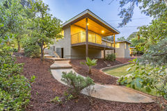 Amazing backyard with paved path, deck and landscaped plants in this modern San Diego home. Outdoors in Southern California homes ready for real estate listings Stock Photography