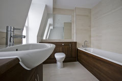 Amazing bathroom with marble. Modern bathroom in white with wood and marble elements Stock Photos