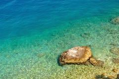 Amazing beach with big stone Stock Photos