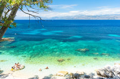 Amazing beach with crystal clear water in Kassiopi in Corfu island, Greece Stock Photography