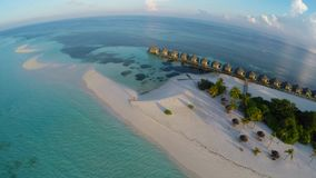 Amazing beach in Maldives during sunset. Aerial view of luxurious water villas in Maldives, Kuredu stock footage