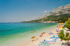Amazing beach with people in Tucepi, Croatia Stock Image