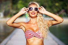 Amazing beautiful blonde girl in sunglasses - close up royalty free stock photo