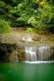 Amazing beautiful deep forest waterfall in Erawan National Park,. Kanchanaburi, Thailand Stock Photos