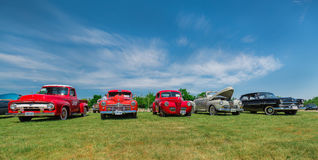 Amazing beautiful front view of classic vintage cars Stock Photos