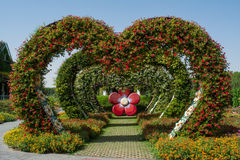 Amazing beautiful green hearts archway alley made from flowers in the garden Stock Images