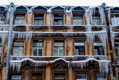 Amazing beautiful house with long icicles on it royalty free stock photo