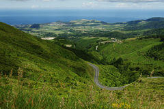 Amazing beautiful landscape view of green mountains and sea on the horizon under vibrant sky in Sao Miguel island of Azores in Por Stock Image