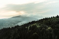 Amazing beautiful landscape view of rocks and forest and sky in. Sunset mountains royalty free stock photography