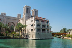 Amazing beautiful luxury resort building shaped like castle standing on the river with a bridge Royalty Free Stock Photography