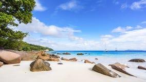 Paradise beach.White sand,turquoise water,palm trees at tropical. Amazing beautiful paradise beach.White sand,turquoise water,palm trees at tropical beach anse Stock Photo