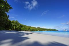 Paradise beach.White sand,turquoise water,palm trees at tropical. Amazing beautiful paradise beach.White sand,turquoise water,palm trees at tropical beach anse Stock Images
