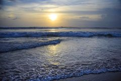 Amazing beautiful sea landscape sunset view of Seminyak Double Six beach in Bali island of Indonesia Royalty Free Stock Photos