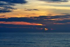 Amazing beautiful Sunrise at sea Scenery, seascape. Amazing colorful sunrise at sea scenery.Dramatic landscape.The black clouds are burning by the sun stock photography