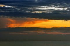 Amazing beautiful Sunrise at sea Scenery, seascape. Amazing colorful sunrise at sea scenery.Dramatic landscape.The black clouds are burning by the sun stock photo