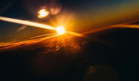 Amazing and beautiful sunset above the clouds with dramatic clouds. During hot summer day royalty free stock photography