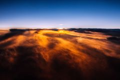 Amazing and beautiful sunset above the clouds with dramatic clouds. During hot summer day stock photos