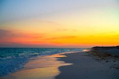 Amazing beautiful sunset on an exotic caribbean beach. Stunning beautiful sunset on an exotic caribbean beach Stock Images