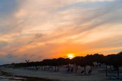 Amazing beautiful sunset on an exotic caribbean beach. Stunning beautiful sunset on an exotic caribbean beach Stock Photography