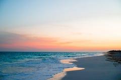 Amazing beautiful sunset on an exotic caribbean seashore. Stunning beautiful sunset on an exotic caribbean beach Royalty Free Stock Image