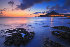Amazing beautiful sunset with sea and mountain Stock Images