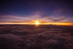 Amazing and beautiful sunset above the clouds with dramatic clouds. Amazing and beautiful sunset/sunrise above the clouds with dramatic clouds stock images