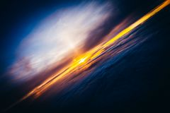 Amazing and beautiful sunset above the clouds with dramatic clouds. Amazing and beautiful sunset/sunrise above the clouds with dramatic clouds royalty free stock photo