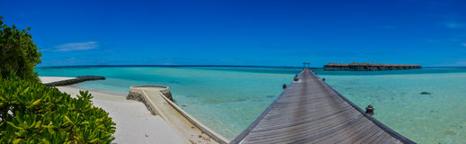 Amazing beautiful tropical beach panorama with water villas on the ocean at Maldives Royalty Free Stock Photo