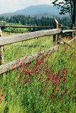 Amazing beautiful view of mountains hills with wooden fence and Royalty Free Stock Images