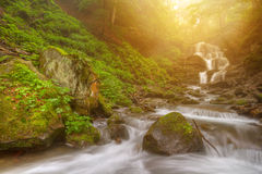Amazing beauty of Alps mountains waterfall. Summer waterfall in Alps with soft sunlight at evening Stock Photography